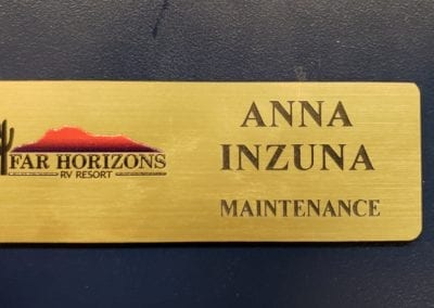 Printed and engraved 1.25 x 3.5 badge Brushed gold